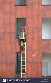 fireman climbs up the ladder during a training exercise stock stock photo fireman climbs up the ladder during a training exercise