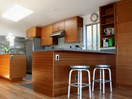 this modern kitchen made up of laminated wooden surfaces and floor plus stainless countertops makes this space chic and a classic beauty chic mini bar design