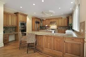 kitchen cabinets with granite countertops: another kitchen unified by the use of natural wood tones on the majority of its surfaces