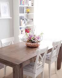 acacia flats dining table rustic and rough hewn the hamburg dining table is equally at home in t