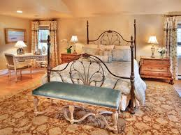bronze rod iron 4 short poster bed frame with curvy headboard and footboard on brown beige bedroom endearing rod iron