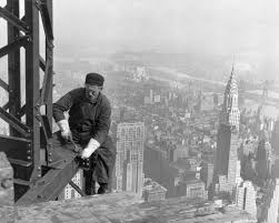 history of new york a frameworker tightens bolts on the empire state building in 1930 the recently completed chrysler building is seen in the background by 1900 new york