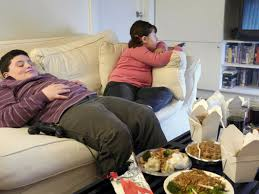Image result for indian kid watching tv and eating