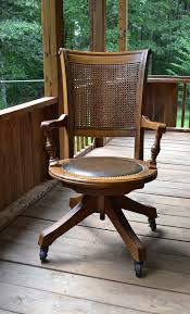 vintage wood oak office chair swivel wheels cane back vinyl seat antique wood office chair
