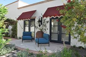 front door window treatments patio mediterranean with awning black door blue apothecary style furniture patio mediterranean