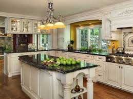 kitchen design cabinets traditional light: amazing traditional kitchen design with black table and white kitchen cabinet ideas furnished with black countertop and completed with pendant lighting
