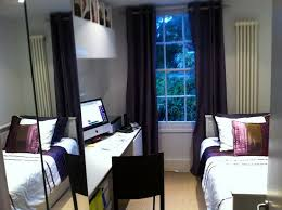 narrow bedroom and home office in dark furniture bedroom home office