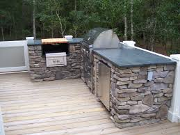 patio outdoor stone kitchen bar: open outdoor kitchen primitive grey stone structure base ideas in backyard combine l shaped and black