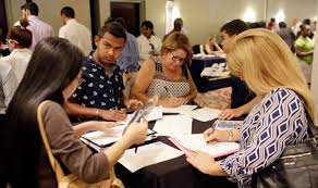 survey us businesses add a modest 153 000 jobs in in a 19 2016 file photo people fill out job applications at a