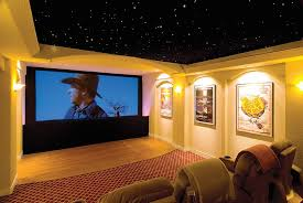 themed family rooms interior home theater: basement home theater plans modern wall mount tv unit rustic wood bar table music theme wall poster black leather sofa exposed stone wall