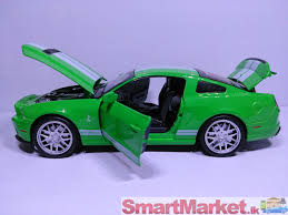 car in 1 36 scale painted green white stripes featuring opening doors rubber tyres excellent attention to detail and a neat pull back action