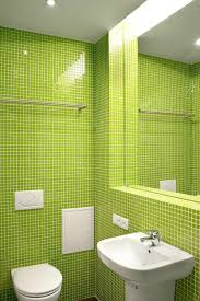 beautiful green wall tile also pedestal sink design and one piece toilet in captivating apartment bathroom captivating bathroom lighting ideas white interior