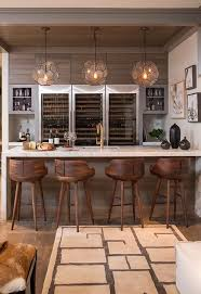 three arteriors beck pendants illuminating a marble waterfall bar fitted with a wet bar sink and check 35 home bar
