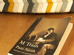"""patti smith s m train satu adam in m train i found that smith has captured well the original everyday moments and especially those moments when you feel present and like """"home"""""""