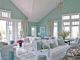 paint colors  modern interior ideas for living room wall color trends  using light blue wall color painting with modern white sofa and luxurious crystal chandelier home interior colors for