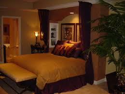 calm basement bedroom ideas with bench and ceiling curtains brightened table light for your totally cozy basement bedroom lighting ideas