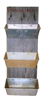 cool repurposed loaf pans and barn wood make great hanging produce storage barn wood ideas