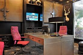 office example of a trendy home office design in kansas city with black walls carpet and alaska black oak office desk