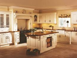 kitchen paint colors with cream cabinets: cream kitchen cabinets with black countertops painting