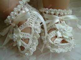 مجموعة رائعو من احذية البيبي بالكروشيه images?q=tbn:ANd9GcS