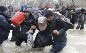 why is the catholic church moving away from just war theory  migrants wade across a river near the greece macedonia border west of the the village of idomeni greece march  migrants are fleeing from war and
