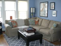 cream couch living room ideas: blue gray and cream living room blue wall with glass windows and pictures plus brown fabric
