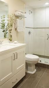ideas bathroom tile color cream neutral: small welcoming cream bathroom features a cream washstand placed on wood like floor tiles and fitted