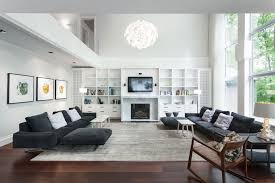 awesome family room flooring ideas with modern ceiling lamps for high ceiling design also using tv above fireplaces awesome family room lighting ideas