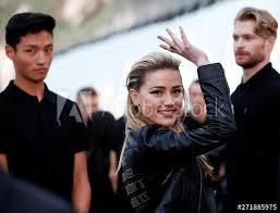 <b>Amber Heard</b> waves at the Saint Laurent <b>Men's</b> Spring/<b>Summer</b> ...