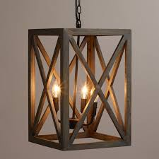 crafted of gray washed mango wood our exclusive chandelier adds a dramatic architectural element amazing wooden chandelier