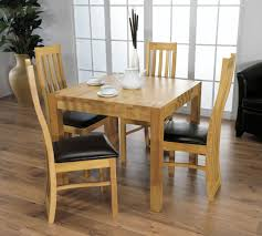 small square kitchen table:  big floor greenery pot design with black leather chairs plus pretty square wood kitchen table with