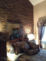 tub faux stone wall accent faux stone panels create a rugged accent wall for a master bedroom thi