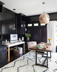 love the black shiny walls the chandelier that matches the pillow and the pops of black shag rug home office