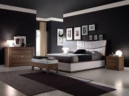 red wall paint black bed: grey wall paint color toward interior wood flooring with green shaggy rug