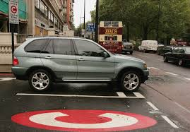 essay it s time to rethink how the world s great cities manage a car leaves london s congestion charge zone in 2006 image getty