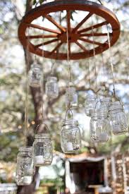 1000 images about rustic lighting on pinterest wagon wheel chandelier wagon wheels and mason jar chandelier alternating length wagon wheel mason jar