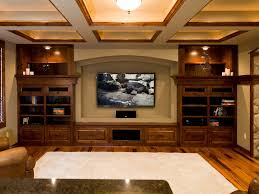 themed family rooms interior home theater: brown l shape upholstered fabric sofa home theater ideas photos awesome wood wall theme modern tv wall unit white favric sofa basement ceiling ideas