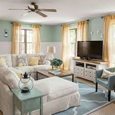 blue and white coastal cottage living room before and after living room makeover beach house living room tropical family room