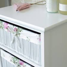 white storage unit wicker: white floral wicker basket storage unit with cupboard
