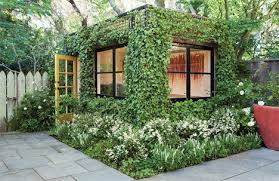 lush ivy covered building is a living backyard home office building home office