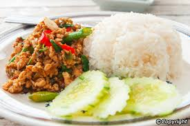 typical thai meals eating habits a staple in aharn taam sung food made to order pad kaprao is spicy stir fried chicken or other meat sweet smelling holy basil leaves
