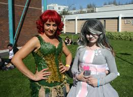 the cosplayers of wales comic con sandra owen as poison ivy batman alexis ellis tait as weighted companion cube portal