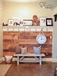 ideas wall shelf hooks: cool  shelf and hooks to match with church pew and board and baton wall treatment