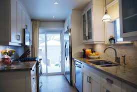 when we renovated our kitchen six years ago we made sure to have our electrician add in an abundance of light sources though you cant tell from the photo add undercabinet lighting