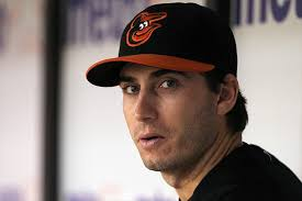 October 1, 2012; St. Petersburg, FL, USA; Baltimore Orioles starting pitcher Miguel Gonzalez (50) in the dugout against the Tampa Bay Rays at Tropicana ... - 6648008