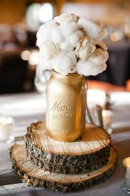cotton golden jars and rustic thin wood stumps great winter wedding centerpieces beautiful classic mason jar