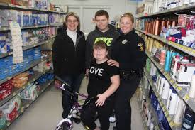 shop a cop helps children have a joyous holiday breaking shopping for a new bike
