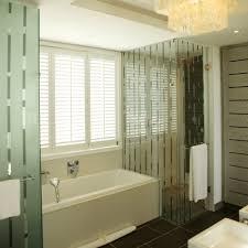coastal bathroom designs:  modern bathroom at contemporary long beach glass striped pattern shower enclosure simple white ceramic bath tub white horizontal blind beach bathroom design interior architecture bathroom modern styl