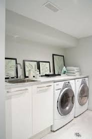 suzie house home peter fallico clean modern laundry room white bright modern laundry room