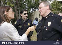 chief of police interview stock photos chief of police interview media hispanic reporter w interview microphone police chief john timoney policeman stock image